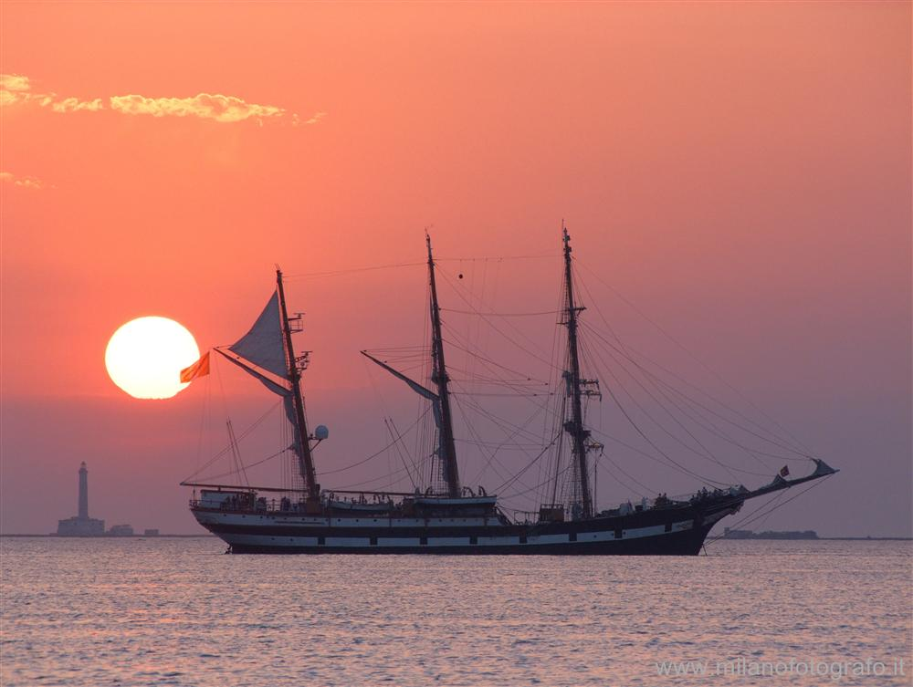 Baia Verde fraction of Gallipoli (Lecce, Italy) - Sunset with ship and Sant'Andrea Island