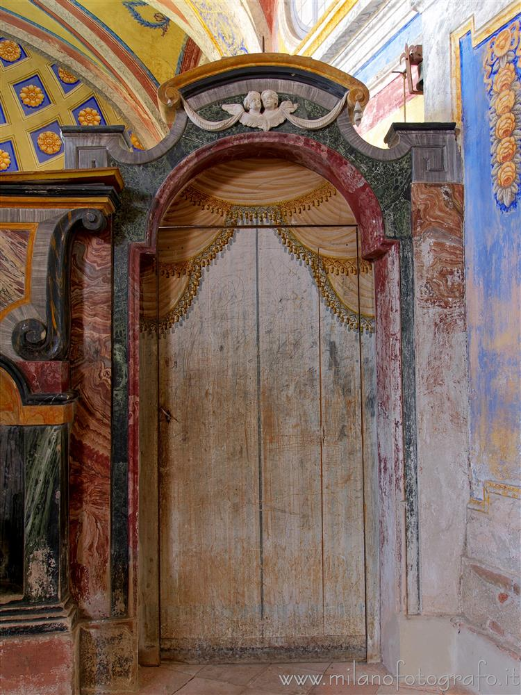 Candelo (Biella, Italy) - Door in painted wood in the Chapel of Santa Marta in the Church of Santa Maria Maggiore