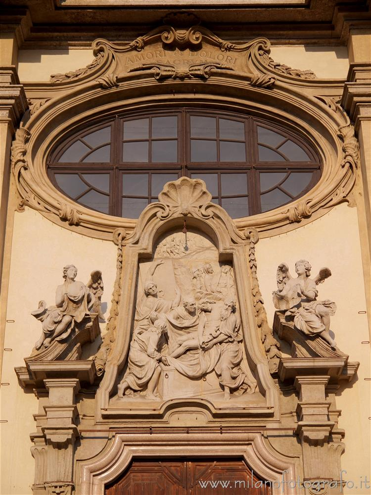 Milan (Italy) - Decorations above the entrance of the Church of Santa Maria della Passione