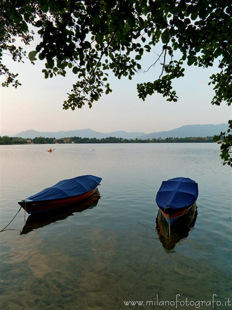 Cadrezzate (Varese, Italy) - Two boats moored in Lake Monate at darkening