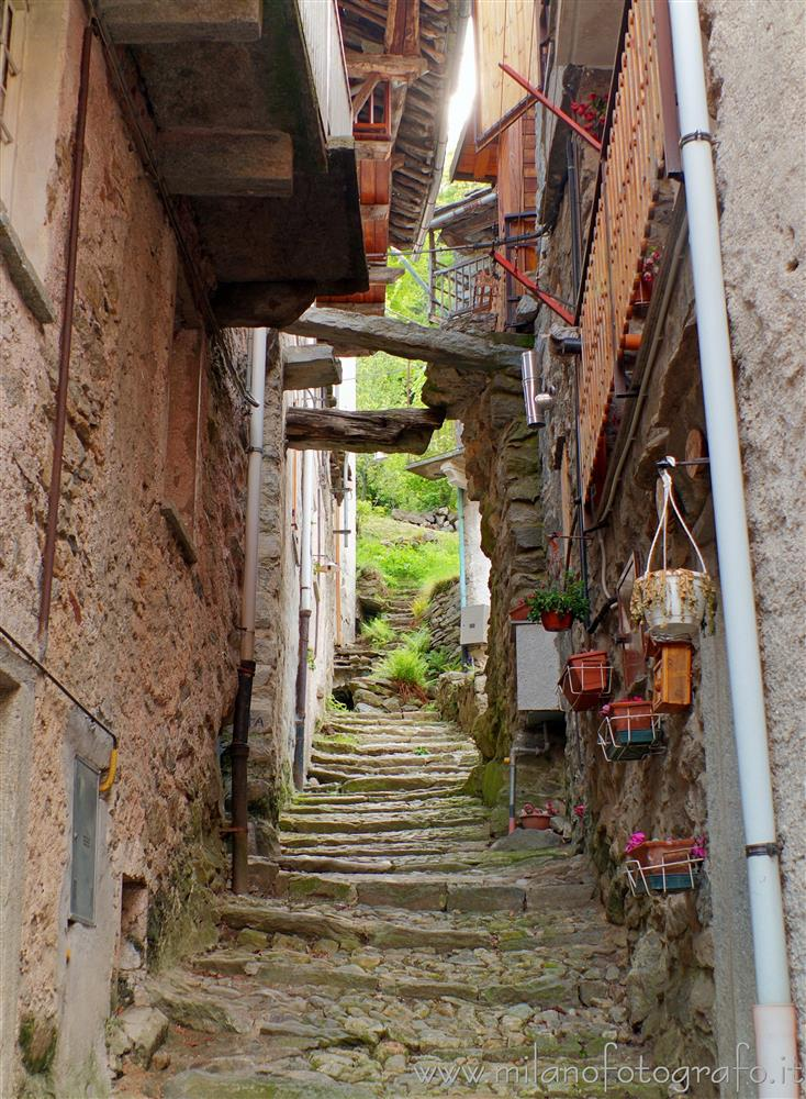 Montesinaro fraction of Piedicavallo (Biella, Italy) - Narrow street between the old houses of the village