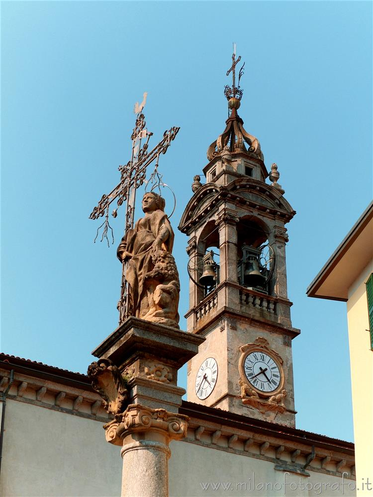 Oggiono (Lecco, Italy) - Column of Sant'Eufemia and bell tower of the Church of Sant'Eufemia