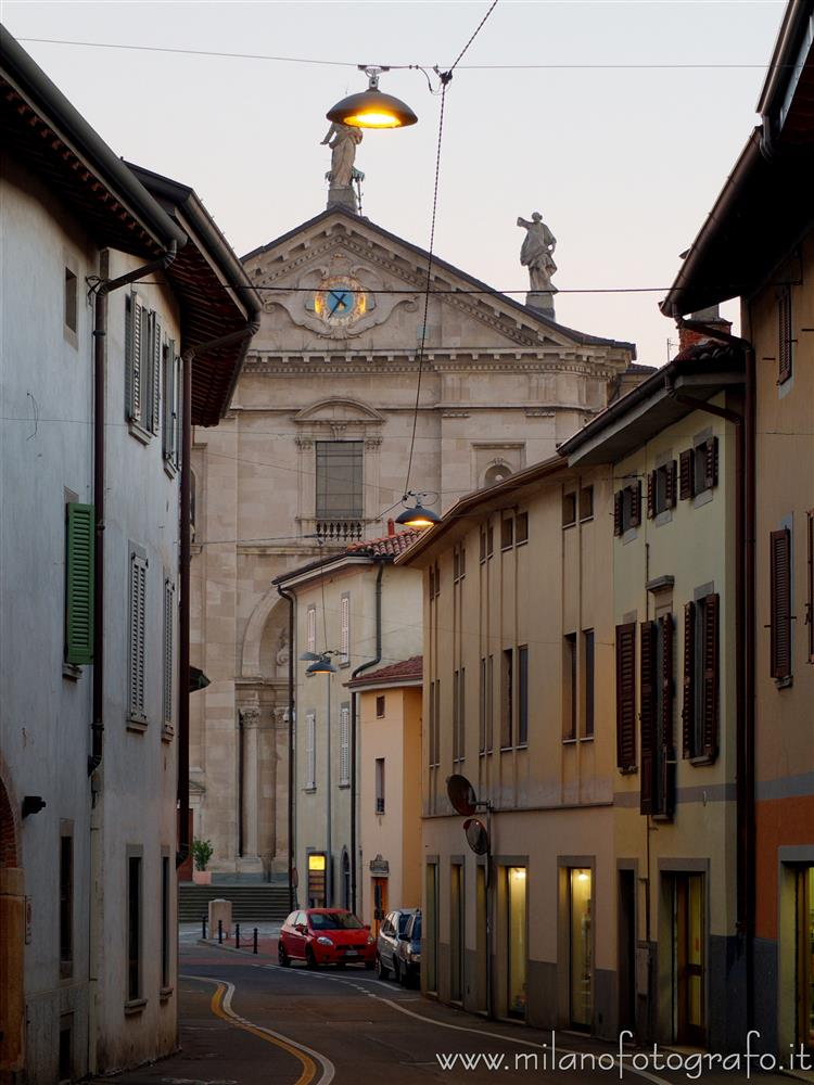 Urgnano (Bergamo, Italy) - The Church of Saints Nazario and Celso at the end of the street at dusk