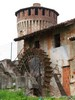 Soncino (Cremona, Italy): Ancient mill and one of the towers of the Fortess of Soncino